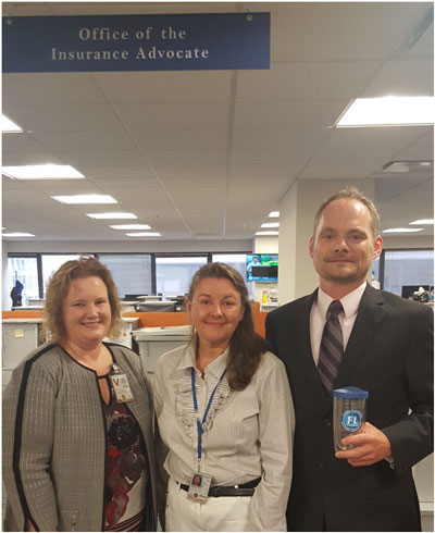 Claire Jubb and Del Schwalls with Rhonda Montgomery, Deputy Director in the Office of the Flood Insurance Advocate