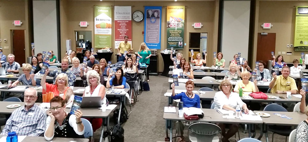 Group of real estate agents participating in the Pinellas County Real Estate Flood Disclosure training  program. Photo taken by Cece McKiernan.
